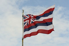 Hawaii State Flag. Against Blue Sky stock photo