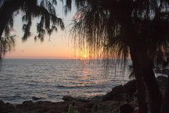 Hawaii sunset. The sun setting into the sea at Hawaii Stock Photography