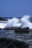 Hawaii surf breaking on lava rocks Stock Photo