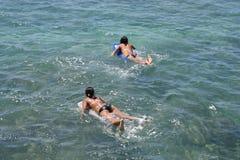Hawaii Teenage girls paddling. Teenage girls paddling at Waikiki Beach, Honolulu, Hawaii Stock Photo