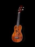 Hawaii ukulele guitar isolated. Against black background Stock Images