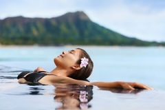 Hawaii vacation wellness pool spa woman relaxing Royalty Free Stock Image