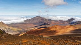 Hawaii - Wide colorful landscape with volcanic craters and cloud shadows royalty free stock photography