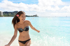 Hawaii woman in bikini swimming on Hawaiian beach Stock Photography