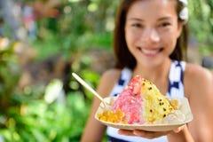 Hawaii woman eating Hawaiian shave ice stock image