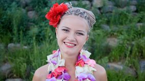 Hawaii woman with flower lei garland of pink orchids. Beautiful smiling caucasian woman in bikini on beach of the stock photo