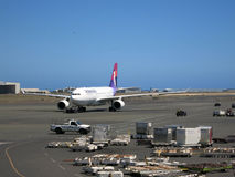 Hawaiian Airlines airplanes taxis out to runway as it prepares f Royalty Free Stock Image