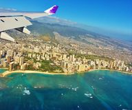 Hawaiian airlines wing of plane above honolulu stock photography