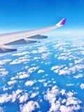 Hawaiian airlines wing of plane. Amazing view of flight in Hawaiian airlines plane ,which has its symbol on the wing ,its professional crew made the trip to Royalty Free Stock Photo