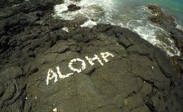 Hawaiian Aloha. White coral rocks spelling the Hawaiian work Aloha on the constrasting volcanic Hawaii coastline Royalty Free Stock Images