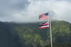 Hawaiian and American Flag. The Hawaiian and American flags flying high together in front of the Koolau Mountains on Oahu, Hawaii Stock Photo