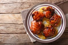 Hawaiian BBQ huli huli: Grilled chicken glazed with pineapple cl. Ose-up on a plate. Horizontal top view from above royalty free stock photo