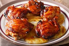 Hawaiian BBQ huli huli: Grilled chicken glazed with pineapple cl. Ose-up on a plate. horizontal royalty free stock photos