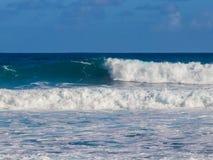 Hawaiian beach with blue waves. Hawaiian beach with blue Pacific ocean waves with blue sky royalty free stock photos