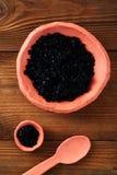 Hawaiian Black lava sea salt  in rustic clay bowls Royalty Free Stock Photos