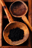 Hawaiian Black lava sea salt in rustic wooden spoon Stock Image