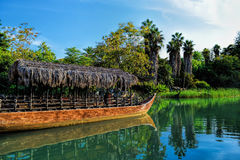Hawaiian boats, amusement park Port Aventura, river and palms, polynesia Royalty Free Stock Images