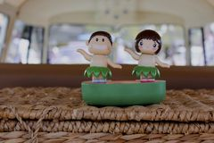 Hawaiian bobble heads. Two hawaiian bobble heads on the picnic table Stock Images