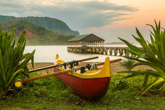 Hawaiian canoe by Hanalei Pier Royalty Free Stock Images