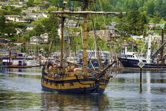Hawaiian Chieftain leaving Newport Port in Oregon. Newport, Oregon,USA - May 25, 2016: Tall ship the Hawaiian Chieftain leaves port at Newport, Oregon for an stock images
