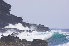 Hawaiian Cliff Fishing. Fishin in Hawaii on the Volcanic Cliffs Stock Photography