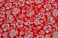 Hawaiian fabric with white flowers Royalty Free Stock Photos
