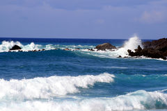 Hawaiian Coastline. Waves of the blue Pacific ocean crashing against the rocks at Waikoloa Hawaii in this picturesque seascape Royalty Free Stock Photography