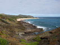 Hawaiian Coastline. With surf crashing against lava rock outcropping Stock Images