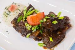 Hawaiian Crockpot Beef Ribs. Slow-cooked beef ribs rubbed with Hawaiian salt seasoning stock images