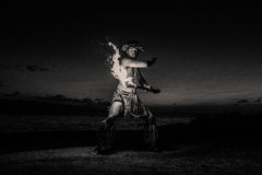 Hawaiian Dancer with fire. Black and white Image of a Hawaiian Dancer Royalty Free Stock Image