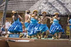 Hawaiian Dancers on Canoe Royalty Free Stock Images