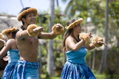 Hawaiian Dancers on Canoe Stock Image