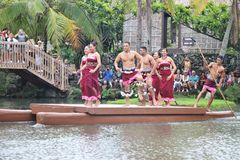 Oahu, Hawaii - 4/26/2018 - Hawaiian dancers performing while riding a canoe float at the Polynesian Cultural Center in Hawaii stock image