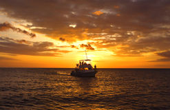 Hawaiian Dive Boat at Sunset Stock Photos