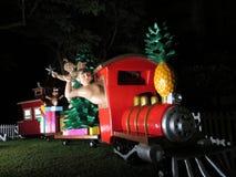 Hawaiian Figures Drive, Shaka, and Ride Christmas Train full of Stock Photos