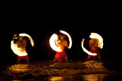 Hawaiian FIre Dancers in the Ocean. Three Strong Men Juggling Fire in Hawaii - Fire Dancers stock image