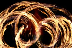 Hawaiian fire dancing. A Hawaiian native dances with fire in the night time Stock Photo