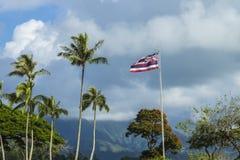 Hawaiian Flag. The Hawaiian Flag flying high with the Koolau Mountains in the background on Oahu, Hawaii Stock Photography