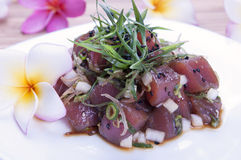 Hawaiian Food (Poke). Hawaiian seasoned raw tuna, poke, with plumeria flowers Royalty Free Stock Photography
