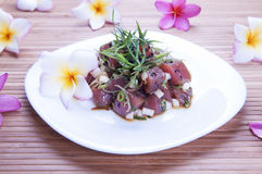 Hawaiian Food (Poke). Hawaiian seasoned raw tuna, poke, with plumeria flowers Stock Photos