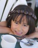 Hawaiian Girl. A little Hawaiian girl is ready to eat dinner Stock Photography