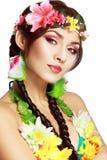 Hawaiian girl make up. Beautiful exotic girl with Hawaiian accessories with perfect make up Stock Photography
