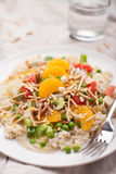 Hawaiian Haystacks. Meal with chicken, sauce, brown rice, mandarin oranges, and other stacked vegetables Stock Images