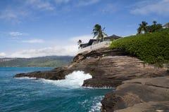 Hawaiian House on the rocky coast line Royalty Free Stock Photography