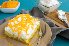 Hawaiian Jello Salad. Hawaiian salad made with lemon jello, pineapple, banana, mini marshmallows, topped with whipped cream and cheddar cheese Royalty Free Stock Image
