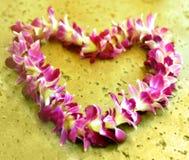 Hawaiian lei. Heart shaped hawaiian lei on the stone floor royalty free stock photo