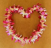 Hawaiian Lei. Heart shaped Pink white and red Hawaiian flower lei Stock Photos