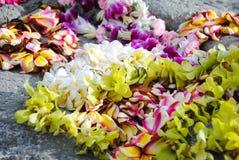 Hawaiian leis on a rock stock photo