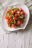 Hawaiian lomi lomi salad close-up on the table. vertical top vie Royalty Free Stock Images