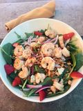 Hawaiian lunch salad with shrimp, greens and strawberries Royalty Free Stock Image